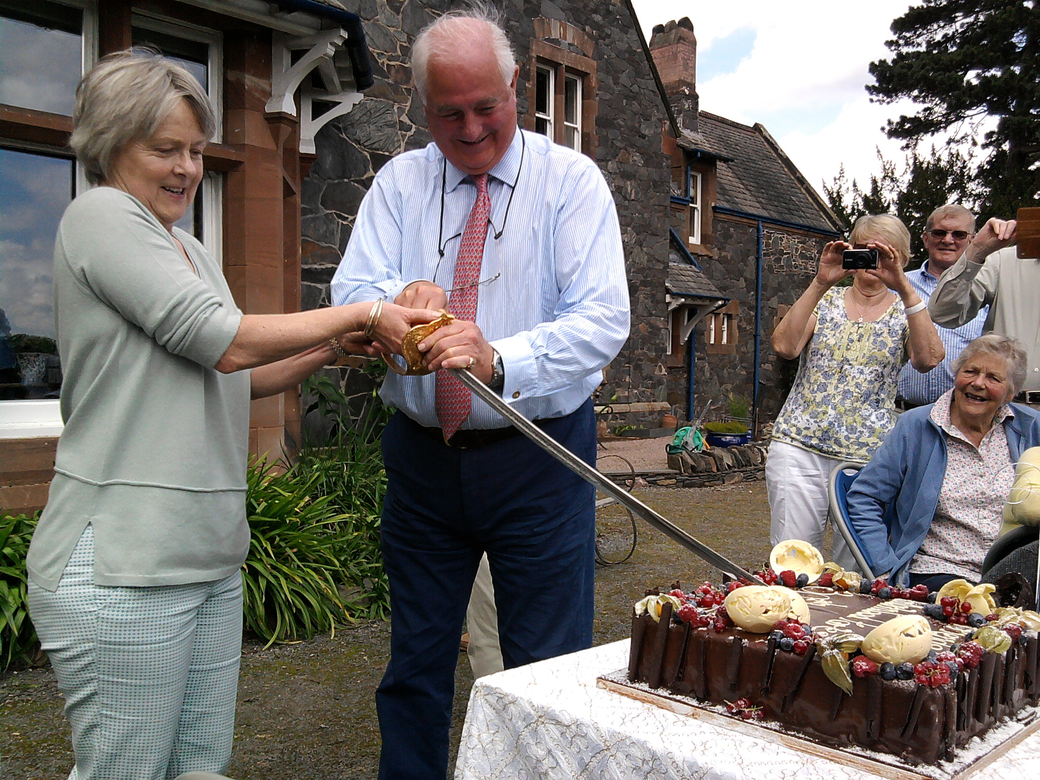 Robert and Janie Martin cutting the Anniversary Cake